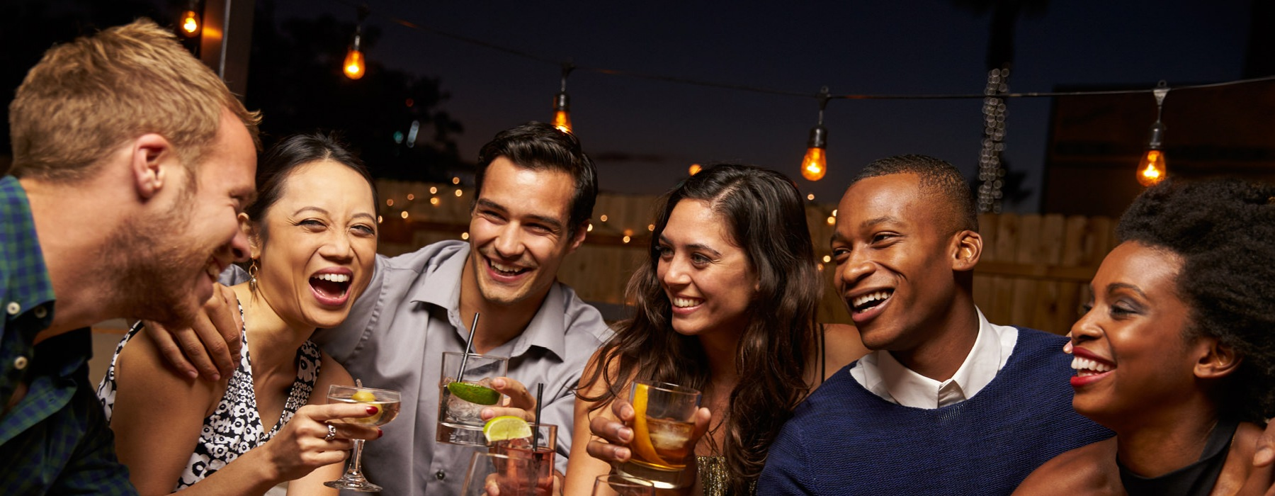 Group of young people enjoying drinks together